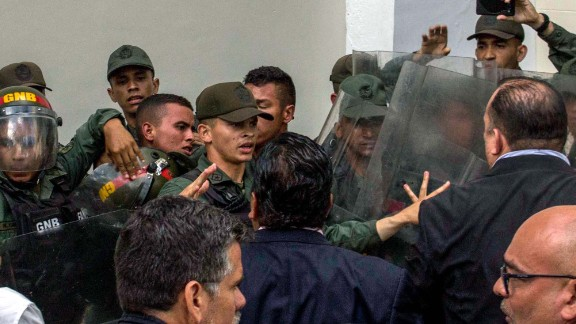 National Guard members clash with deputies of the National Assembly in the Parliament