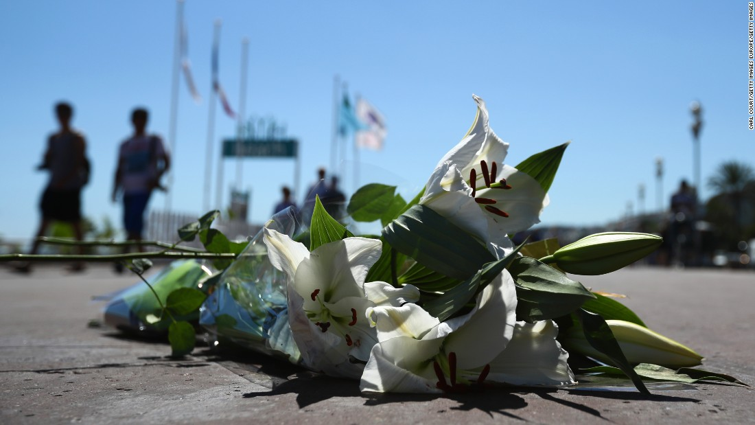 Flowers lie on the ground where a person was killed on the Promenade des Anglais.
