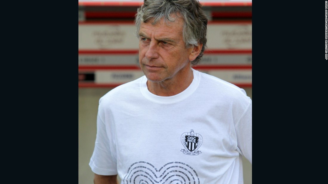 Rennes' coach Christian Gourcuff wears a T-shirt in tribute to the victims of the Bastille Day attack in Nice as he looks on before the French Ligue 1 football match between OGC Nice and Rennes on August 14, 2016, at the Allianz Riviera stadium in Nice.