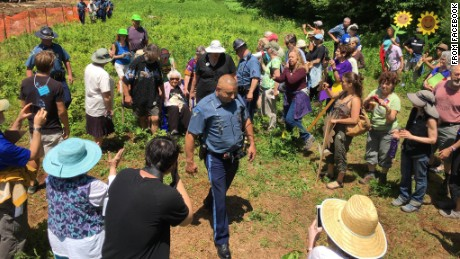 Massachusetts State Police officer arrests long time peace activist, 98 year-old Francis Crowe, and eight others.
