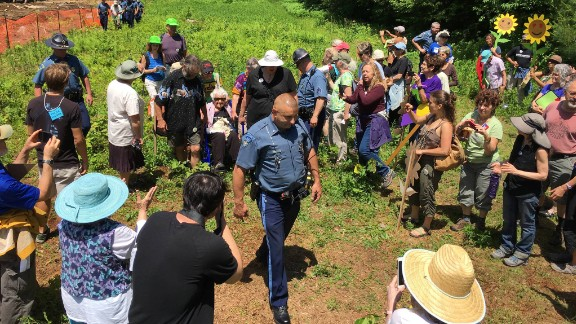 A Massachusetts State Police officer arrests longtime peace activist Frances Crowe and eight others.