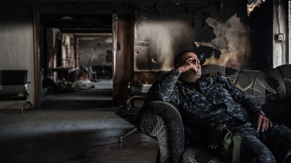 An Iraqi federal policeman smokes during a break from battle on Wednesday, April 12.