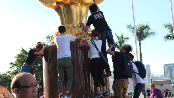 Pro-democracy protesters storm Golden Bauhinia Square in central Hong Kong on Wednesday.