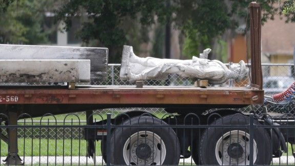 "The top section of a Confederate statue called ""Johnny Reb"" is loaded on a truck before being removed from a downtown park Tuesday, June 20, 2017, in Orlando, Fla. The statue will be relocated to a Confederate section of a nearby cemetery."