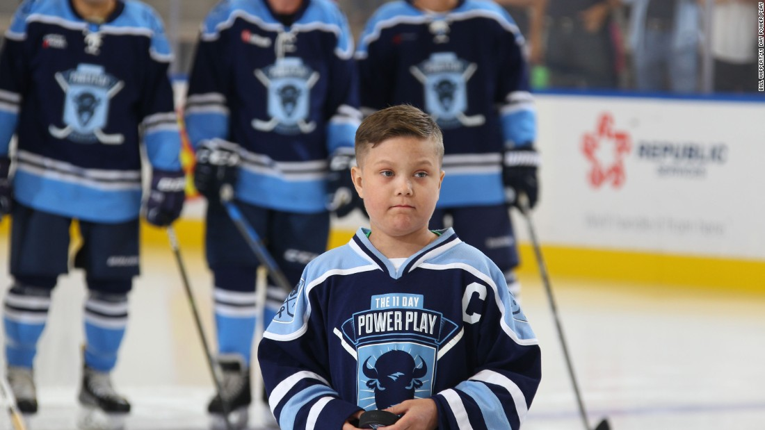 11-year-old Emmett Jakubowski, a cancer survivor, prepares to drop the opening puck at the 11-day record bid aimed at raising funds for cancer research.