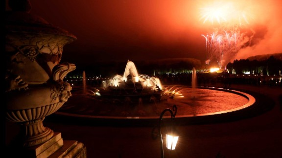 Fireworks light the sky in front of the Grand Canal during the Night Fountains show in the palace gardens.