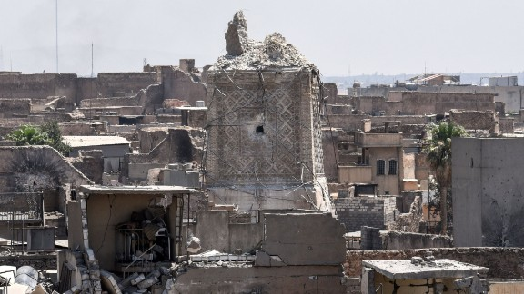 "The remnants of Mosul's ancient leaning minaret are seen in the Old City on Sunday, June 25. ISIS' claim that US warplanes were responsible for the destruction of the minaret is ""1,000% false,"" US officials told CNN."