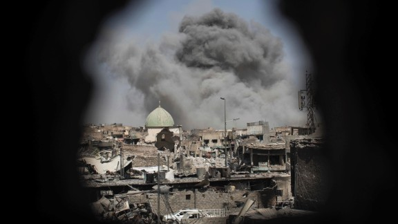 A bomb explodes near the al-Nuri mosque complex on Thursday, June 29. Iraq