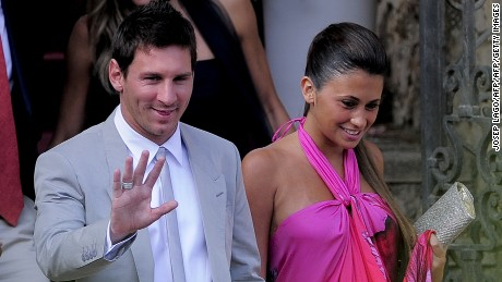 Barcelona's foward Lionel Messi and his girlfriend Antonella Roccuzzo arrive for the wedding ceremony of Spain's midfielder Andres Iniesta in Altafulla, near Tarragona on July 8, 2012. AFP PHOTO/ JOSEP LAGO        (Photo credit should read JOSEP LAGO/AFP/GettyImages)