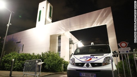 A police vehicle is stationed outside a mosque June 29, 2017 in the Paris suburb of Creteil after a man tried to drive a car into a crowd in front of the Islamic religious facility.