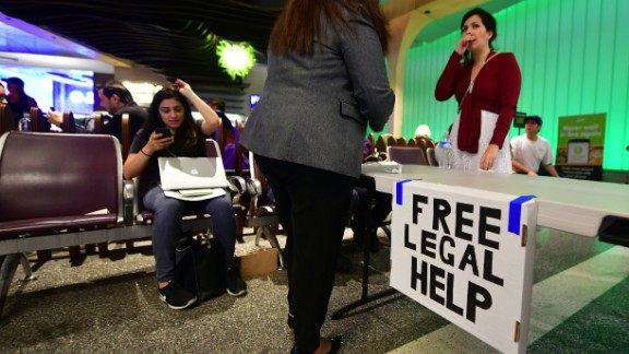 A table is set up for lawyers offering free legal advice inside the International Arrivals section at Los Angeles International Airport on June 29, 2017.