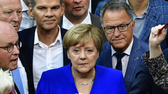Chancellor Angela Merkel and other lawmakers line up to vote on same-sex marriage.