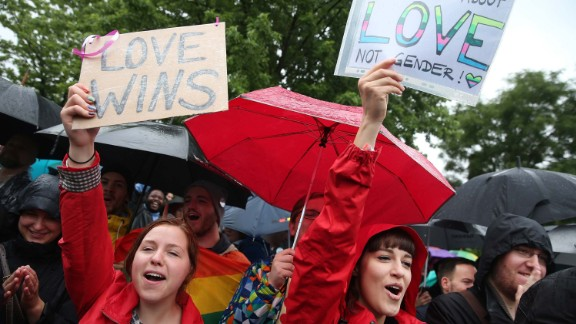 Supporters of gay rights celebrate following the vote Friday at the nearby Bundestag.