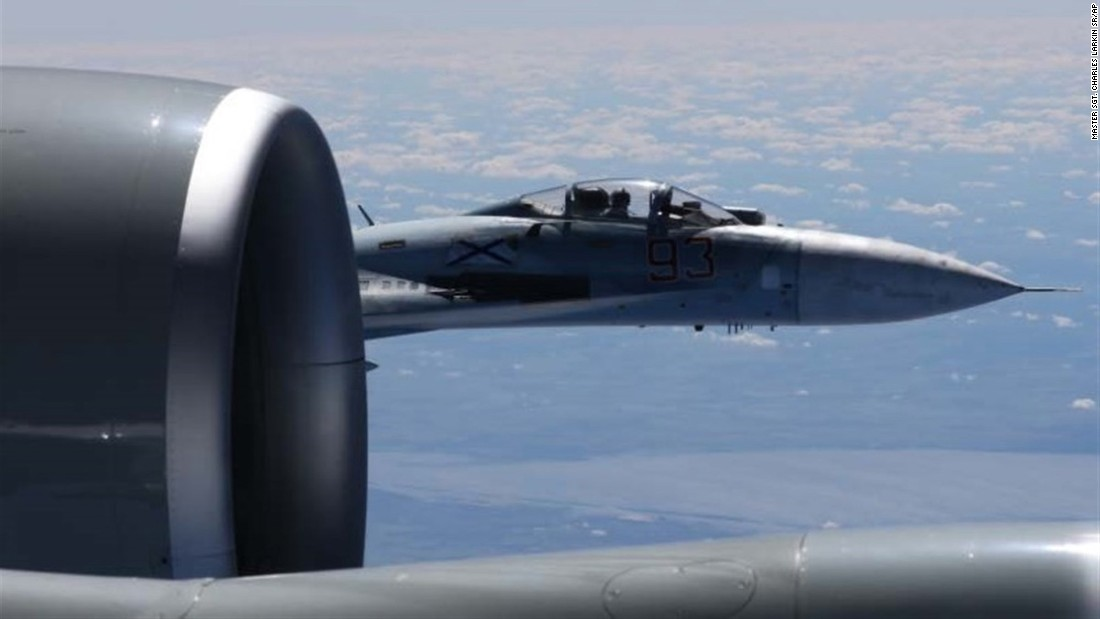 A Russian jet comes within a few feet of a U.S. Air Force reconnaissance jet over the Baltic Sea on June 19 in a maneuver that has been criticized as unsafe. The photo shows the Russian SU-27 in the background, and the wing of the U.S. RC-135U in the foreground.