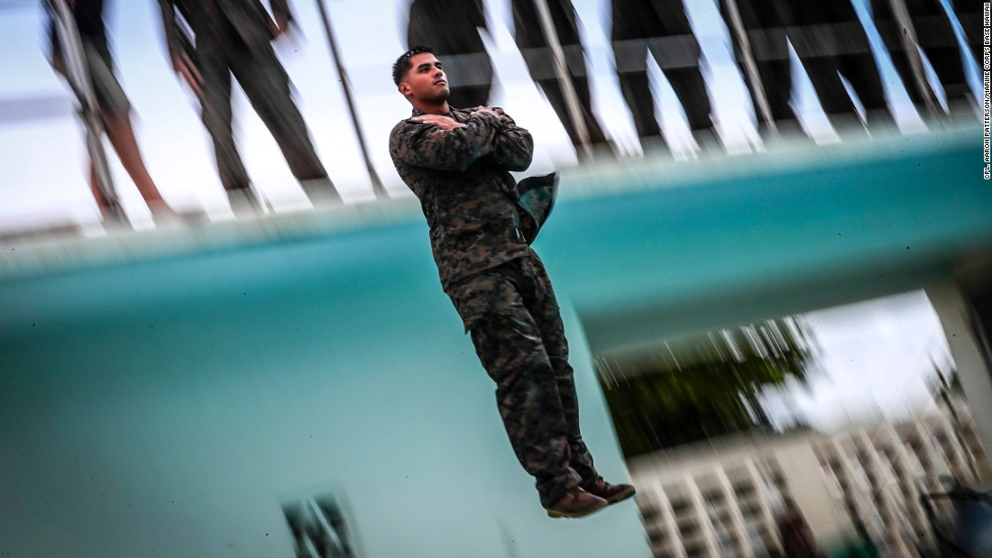 Lance Cpl. Bando Camposvilla jumps from a ten foot high tower during annual swim qualification aboard Camp Hansen, Okinawa, Japan, on June 25. The Marines complete their swim qualification to build confidence and increase survivability in the water.