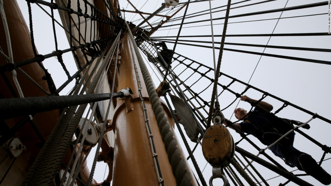 Cadets climb the rigging while preparing to set sail aboard the US Coast Guard Eagle during the Parade of Sail at Sail Boston on Saturday, June 17. The Eagle led the flotilla around the Boston Harbor.