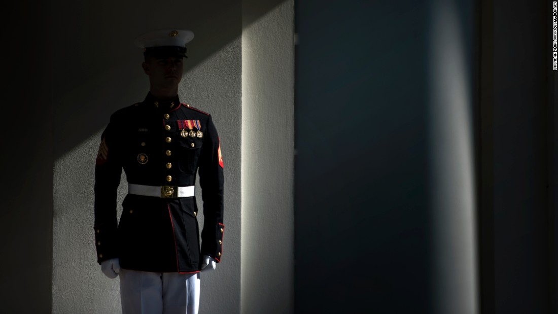 A member of the US Marine Corps stands guard outside the West Wing of the White House while US President Donald Trump works on June 6.