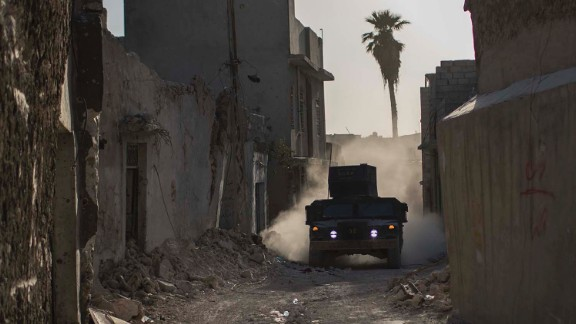 An Iraqi special forces humvee rides through the Old City as fighting continues against ISIS militants in Mosul on Thursday.