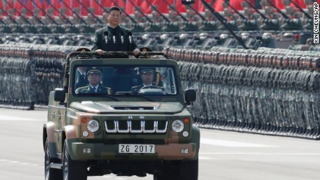 Chinese President Xi Jinping inspects the People's Liberation Army of the Hong Kong Garrison at the Shek Kong Barracks in Hong Kong, Friday, June 30, 2017. Xi landed in Hong Kong Thursday to mark the 20th anniversary of Beijing taking control of the former British colony, accompanied by a formidable layer of security as authorities showed little patience for pro-democracy protests. (AP Photo/Kin Cheung)