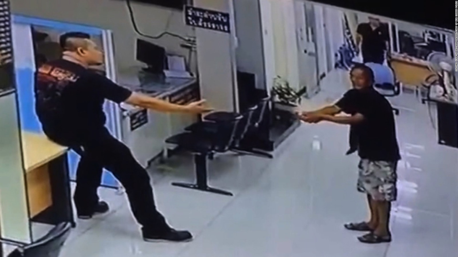 Image result for Cops stops man with knife, hugs him