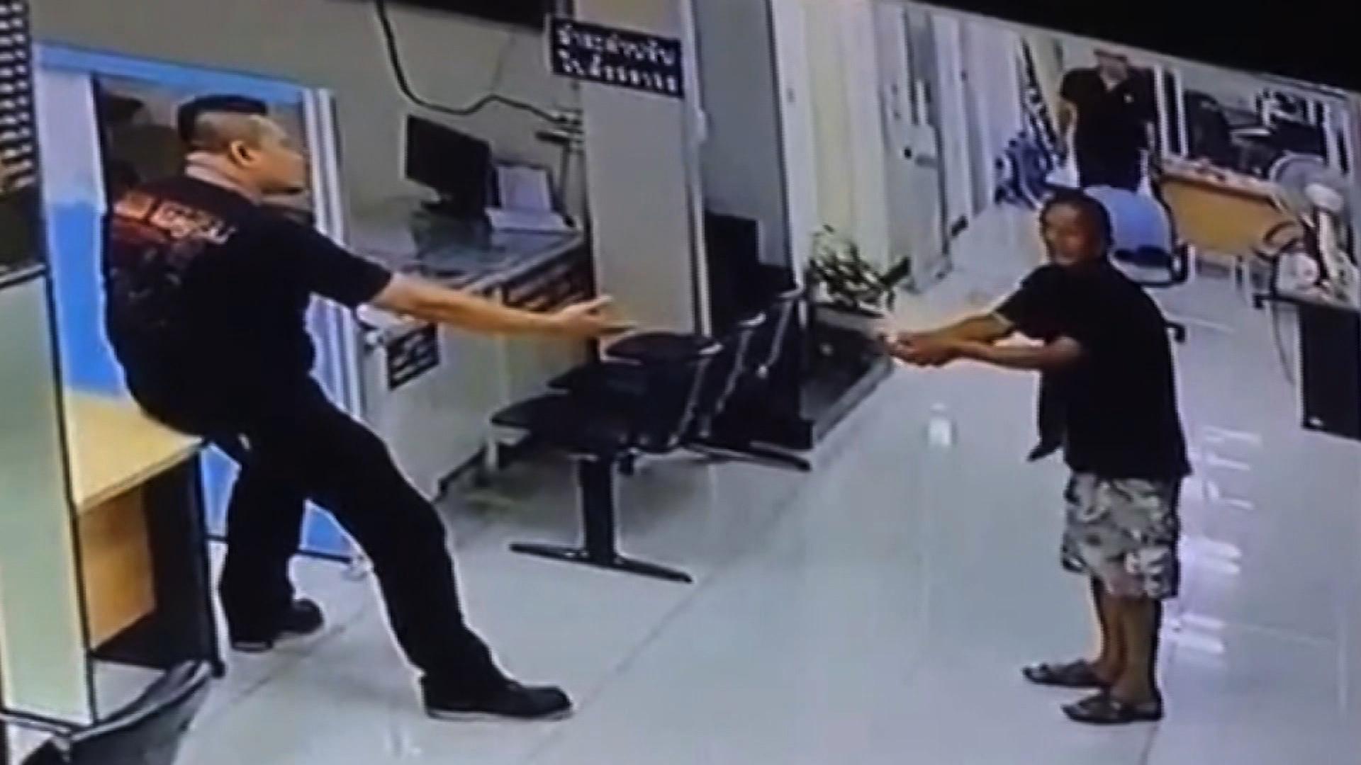 policeman stops thug on the street