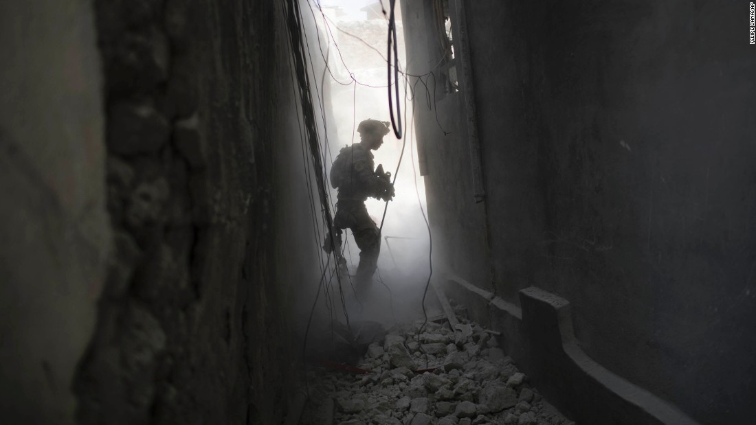 An Iraqi Special Forces soldier exchanges fire with ISIS militants in the Old City on Friday, June 30.