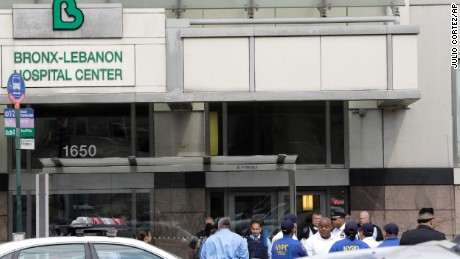 Officials gather outside the Bronx-Lebanon Hospital Center after the shooting Friday.