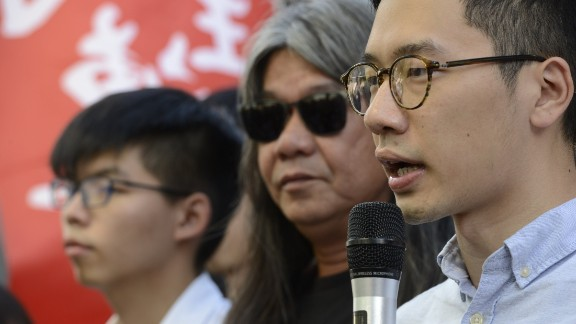 """Nathan Law (right) speaks alongside fellow disqualified lawmaker """"Longhair"""" Leung Kwok-hung and Joshua Wong."""