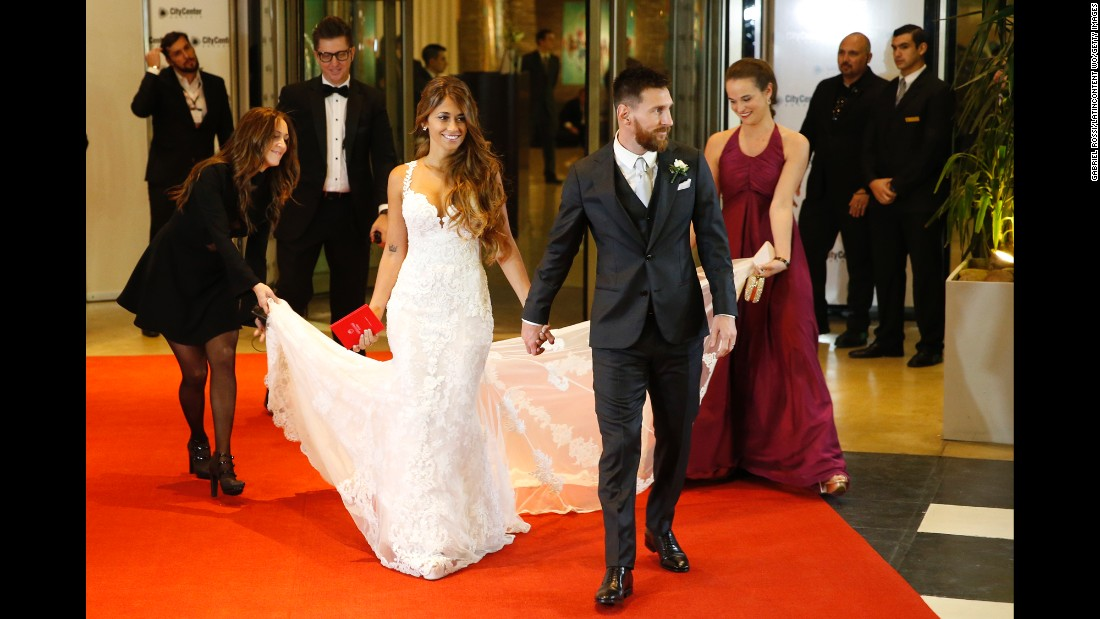 Soccer star Lionel Messi, right, and Antonela Rocuzzo pose for pictures at their wedding on June 30, 2017 in Rosario, Argentina.