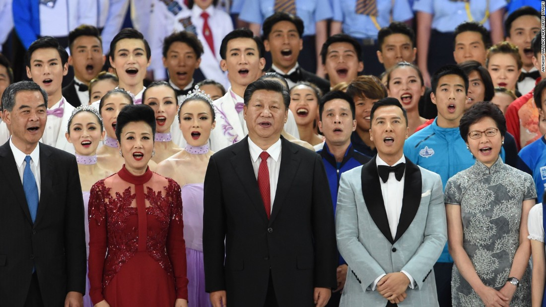 "With Hong Kong's leaders, China's President Xi Jinping sings a song entitled ""My Country"" at a gala event in Hong Kong to mark 20 years since the handover of the city from British to Chinese rule."