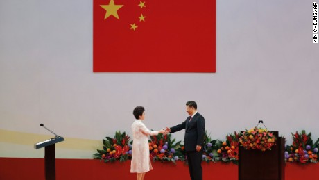 Chinese President Xi Jinping, right, shakes hands with Hong Kong's new Chief Executive Carrie Lam after Xi administered her oath-taking ceremony.