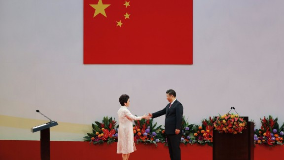 Chinese President Xi Jinping, right, shakes hands with Hong Kong