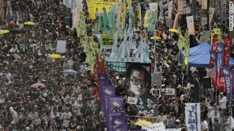 Protesters carry a large image of jailed Chinese Nobel Peace laureate Liu Xiaobo as they march during the annual pro-democracy protest in Hong Kong, Saturday, July 1, 2017.