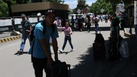 Victor Martinez, who is out of school due to protests, makes the cross-border journey to buy supplies for his family.