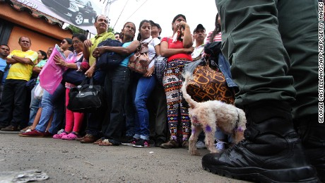 "People wait to cross the Francisco de Paula Santander international bridge, linking Urena, in Venezuela and Cucuta, in Colombia, despite the border closing order issued by the Venezuelan government, on December 18, 2016. President Nicolas Maduro delayed until January 2 taking Venezuela's highest denomination bill out of circulation but the borders with Colombia and Brazil will remain closed to hit what he claims are ""mafias"" hoarding Venezuelan cash abroad in a US-backed plot to destabilize the country. In Tachira, the crackdown caused added misery for people who rely on cross-border trade. / AFP / George Castellanos        (Photo credit should read GEORGE CASTELLANOS/AFP/Getty Images)"