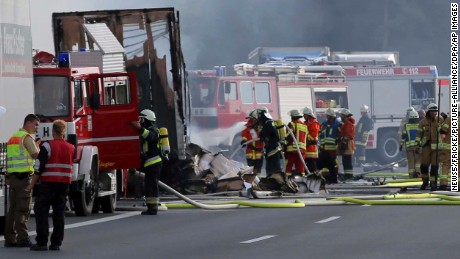Fire fighters and emergency services can be seen at the motorway A9 near Münchberg, Germany.