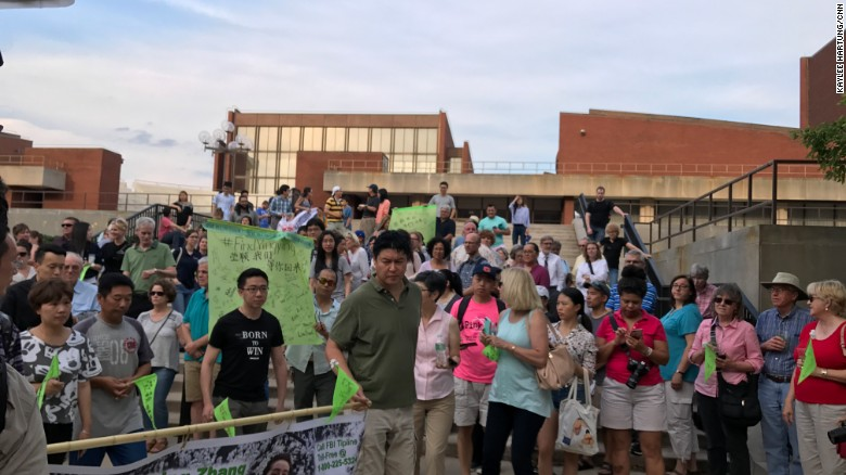 Brendt Christensen, who has been accused of kidnapping University of Illinois graduate student, Yingying Zhang, can be seen in the black t-shirt in the upper right side of this photo attending a rally for Zhang on July 29 on the Champaign--Urbana, Illinois campus.