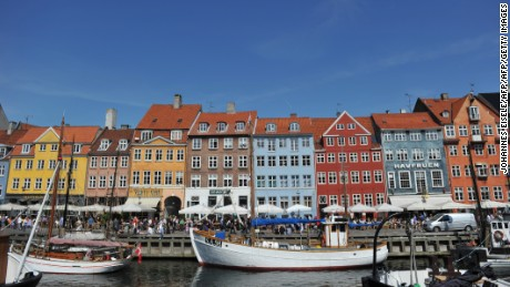 Coulourful houses and boats can be seen in the Nyhavn district in Copenhagen on August 10, 2010. Denmark will play against Germany in a friendly football match in Kopenhagen on August 11, 2010. AFP PHOTO JOHANNES EISELE        (Photo credit should read JOHANNES EISELE/AFP/Getty Images)