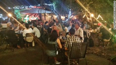 Locals enjoy food, wine and entertainment in the courtyard of the Bacchanal.