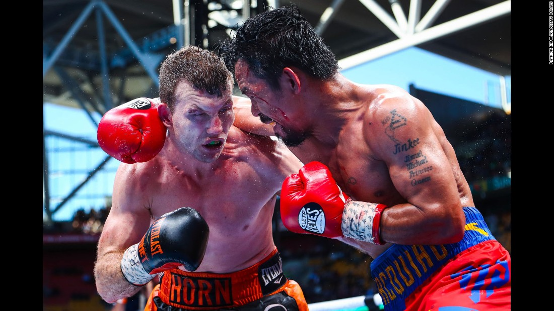 "Jeff Horn ducks under a Manny Pacquiao punch during their welterweight title fight in Brisbane, Australia, on Sunday, July 2. Horn won by unanimous decision, <a href=""http://www.cnn.com/2017/07/02/sport/horn-pacquiao-boxing-brisbane/index.html"" target=""_blank"">but many thought the judges got it wrong.</a>"
