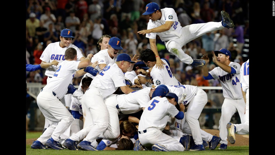 Nick Horvath leaps into the dog pile as Florida's baseball team celebrates a national title on Tuesday, June 27. The Gators defeated LSU in the finals of the College World Series.