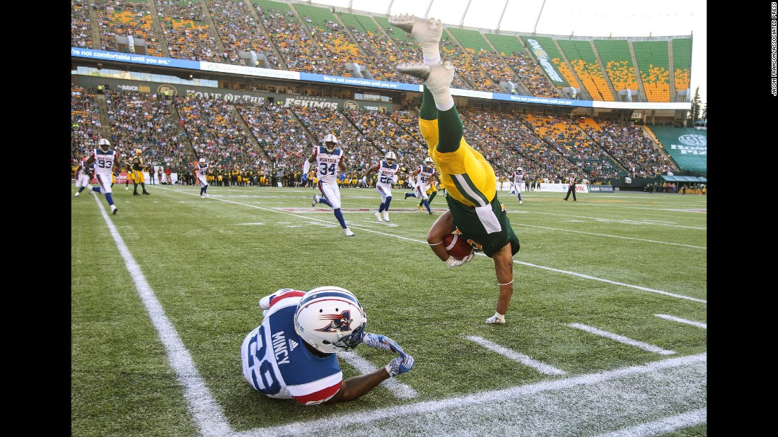 Montreal's Jonathon Mincy tackles Edmonton's Calvin McCarty during a Canadian Football League game on Friday, June 30.