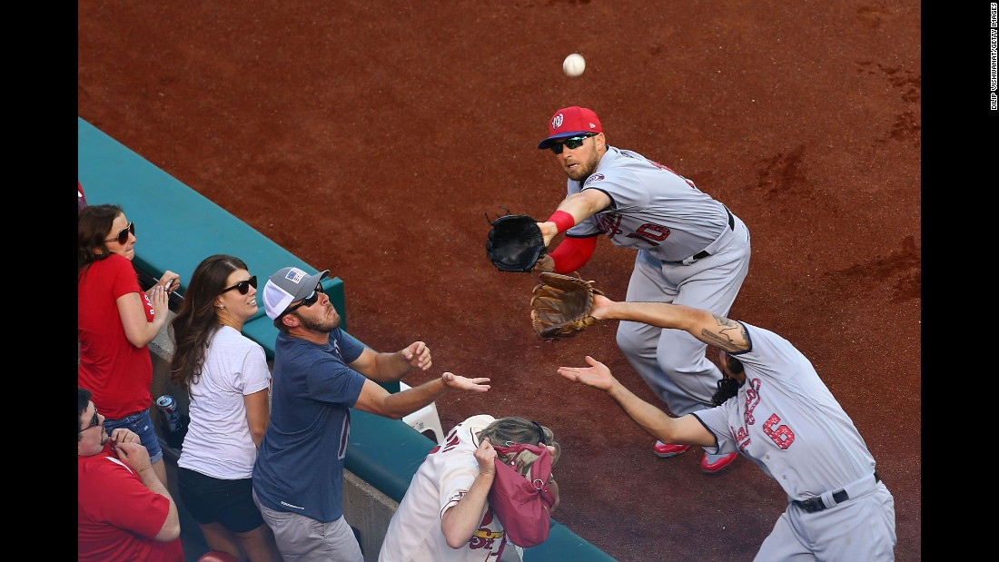 Washington's Anthony Rendon, right, and Stephen Drew try to catch a foul ball during a Major League game in St. Louis on Saturday, July 1.
