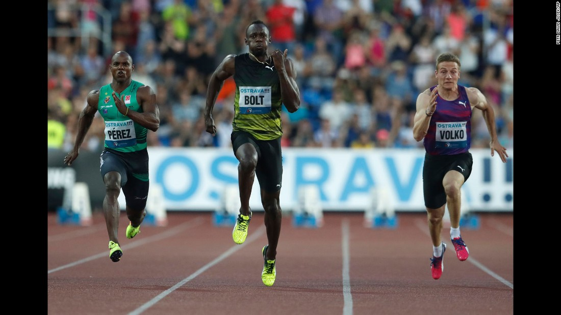 Jamaican sprinter Usain Bolt, the world's fastest man, is flanked by Cuba's Yunier Perez and Slovakia's Jan Volko during a 100-meter race Wednesday, June 28, in Ostrava, Czech Republic. Bolt won the race, holding off Perez by 0.03 seconds.