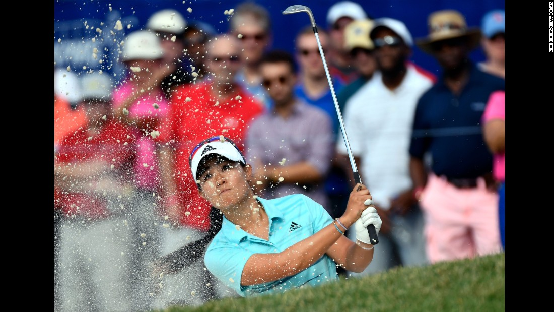 "Danielle Kang plays a shot out of the bunker during the third round of the LPGA Championship on Saturday, July 1. The 24-year-old American <a href=""http://www.cnn.com/2017/07/03/golf/danielle-kang-lpga-championship-olympia-fields/index.html"" target=""_blank"">won the tournament</a> for her first career major."