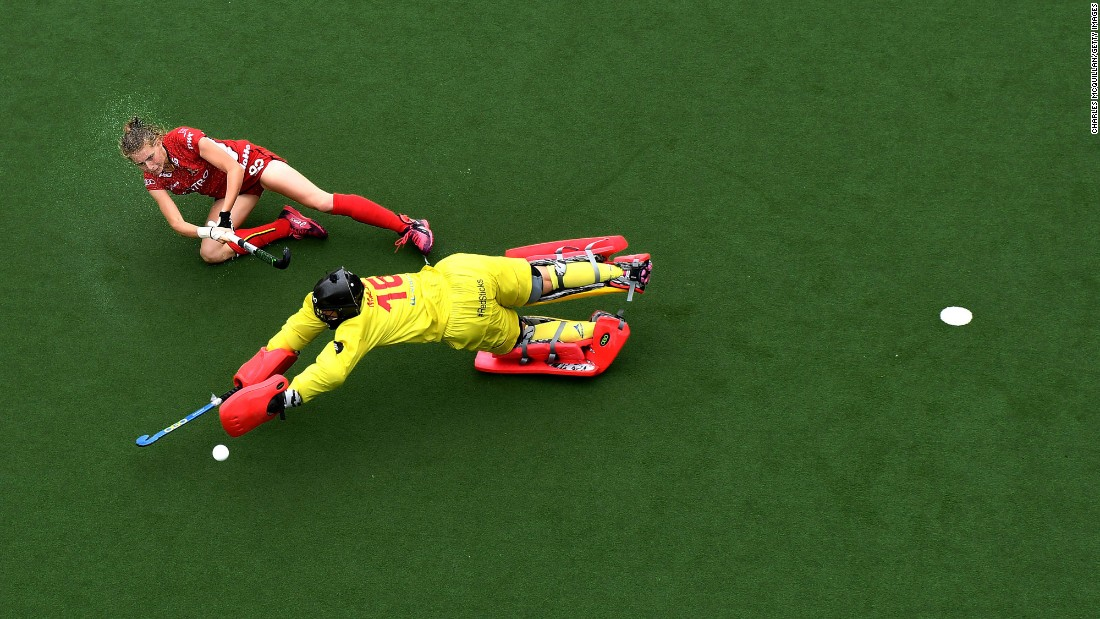 Belgian field-hockey player Stephanie Vanden Borre scores on Spain's Maria Ruiz during a penalty shootout Sunday, July 2, in Brussels, Belgium.