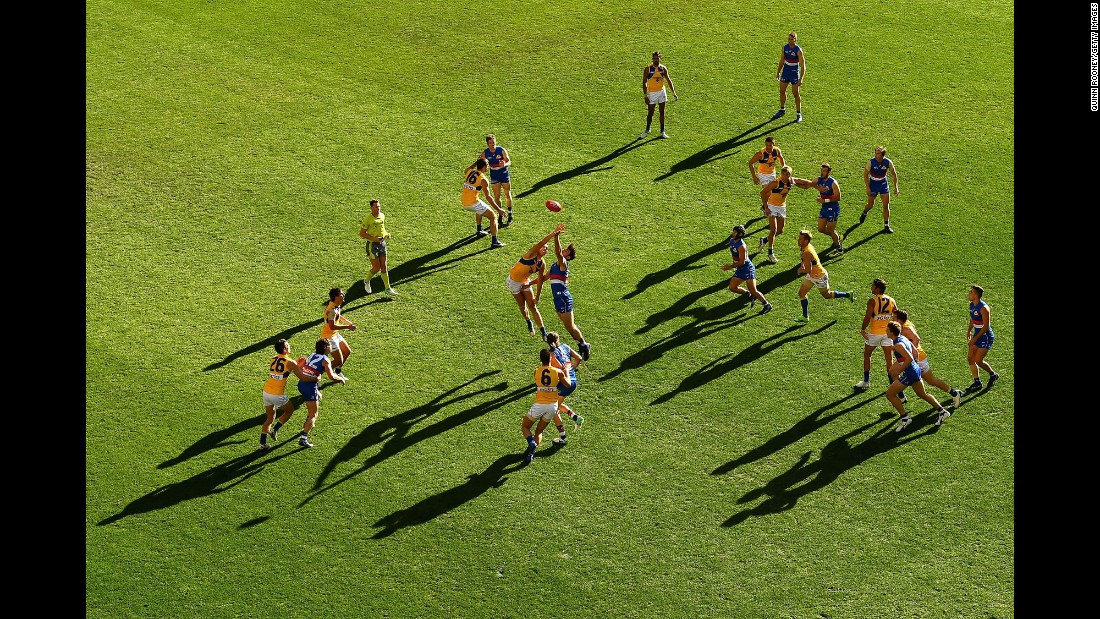 Players from the Western Bulldogs and the West Coast Eagles leap for a ball during an Australian Football League match in Melbourne on Saturday, July 1.