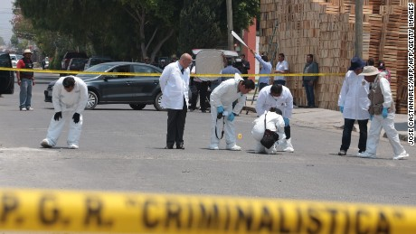 Attorney General of the Republic (PGR)forensic experts look for evidence at the site where Mexican army soldiers allegedly executed a civilian during a shootout days ago, in Palmarito Tochapan, Puebla, Mexico on May 11, 2017.  A video showing the military allegedly executing a civilian led to a wave of outrage in Mexico and opened the debate again about the Army's action in the fight against organized crime. / AFP PHOTO / JOSE CASTAÑARES        (Photo credit should read JOSE CASTANARES/AFP/Getty Images)