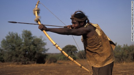 A Hadza man hunting with bow and arrow, Lake Eyasi, Tanzania.