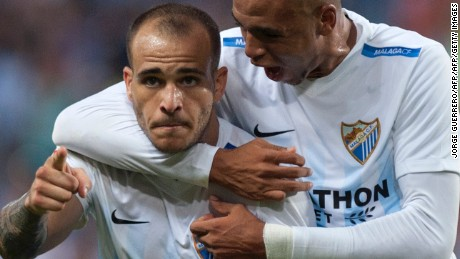 Malaga's forward Sandro Ramirez (L) celebrates with Malagas Morocco forward Youssef En-Nesyri after scoring during the Spanish league football match Malaga CF vs Athletic Club Bilbao at La Rosaleda stadium in Malaga on October 2, 2016. / AFP / JORGE GUERRERO        (Photo credit should read JORGE GUERRERO/AFP/Getty Images)